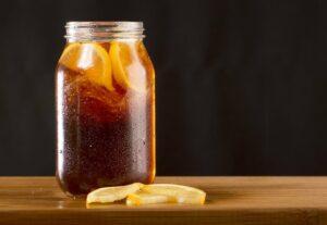 mason jar of upteamus tea with lemon wedges