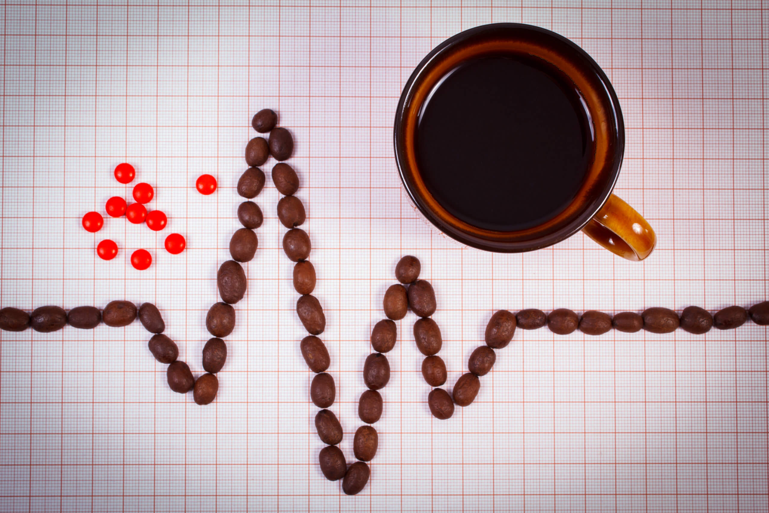 Cardiogram Line of Coffee Grains and a Cup of Coffee